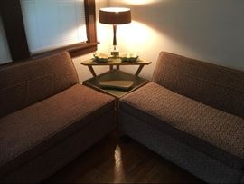 Mid century couch, corner table, and lamp.