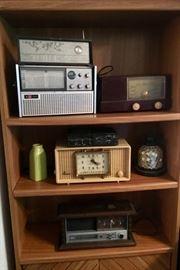 Sharp transistor radio, GE Clock, Marantz professional tape recorder, Sylvania clock, RCA clock.