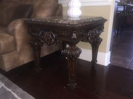 Carved mahogany marble top end table