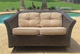PVC wicker loveseat rocker, one of two available