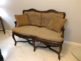 anitique handcraved settee wood with cane back and seat see the next few pictures for better viewing