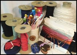 A sampling of the many sewing notions including elastic, trim, raffia, silk cording and more