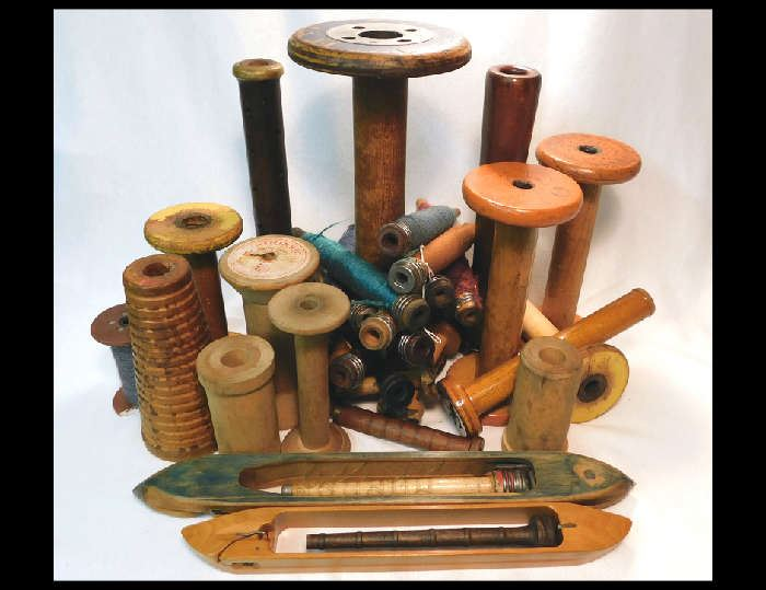 Antique spools , spindles and shuttles