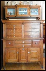Beautiful oak dental cabinet with glass knobs 41 inches wide by 18 inches deep by 63 inches tall