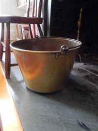 Copper fireplace pot.
