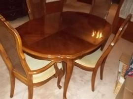 dining table and chairs and two leaves