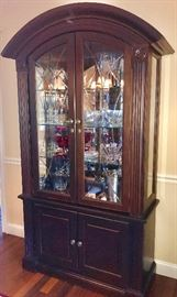 China cabinet full of beautiful crystal pieces