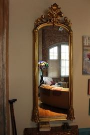 Mirror measures approximately 31 inches wide by  85 inches tall by 12 inches deep at the top.