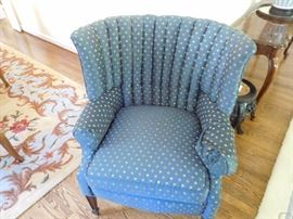 one  of  two  wingback  chairs