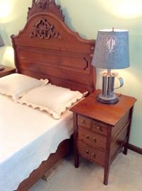 Antique walnut bed and side tables.