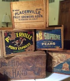 Several vintage wooden crates with advertising.