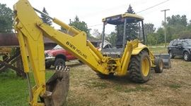 New Holland backhoe with extra trencher bucket