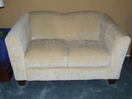 CONTEMORARY IVORY COLORED SOFA LOVE SEAT IN EXC ELLENT CONDITION. FIRM, BUT COMFY.