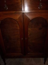 Antique dresser with enclosed drawers
