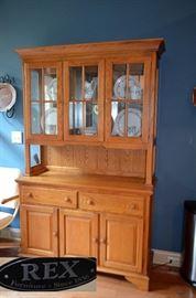 Oak step-back cupboard by REX Furniture Co.