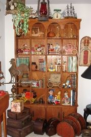 Hand built bookcase with books and collectibles, nested suitcases & Dietz lamp with red glass