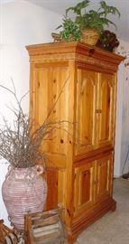 Pine TV armoire, laundry roller, terra cotta vase