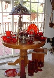 Oak table with leaf, Tiffany style lamp,  wood planter and red glass pieces