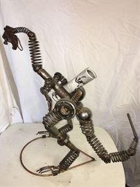 Metal sculpture by Glenn Donovan. A work of art approximately 2' tall. Retail cost $500.