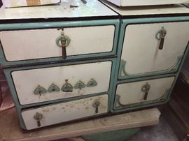 Antique porcelain stove in teal and white.
