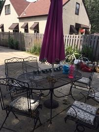 black wire, sturdy patio table with six chairs that rock and swivel