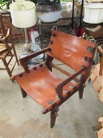 Awesome vintage leather and wood frame chair with wood pins.