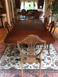 Elegant Dining table with leaves and pads, upholstered chairs