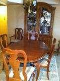 Stanley furniture, oak dining room set, 6 chairs ,2 leaves, and table pads.
