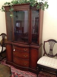 Duncan Phyfe china cabinet; host chair and side chair sold separately