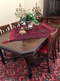 Antique dining table; gorgeous candelabras; four antique chairs sold separately from the table