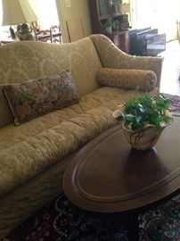 Fabulous gold sofa, oval coffee table, and glass art bowl