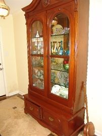 Antique walnut china cabinet with glass shelves and mirrors