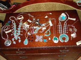 Large collection of Navajo jewelry including 2 Squash blossom necklaces