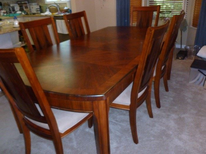 Beautiful table and 8 chairs (only 6 shown) from Carol House