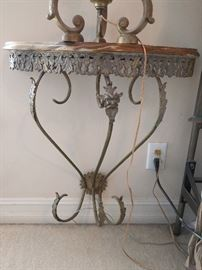 Very nice wall-hung wrought iron table, with onyx top.