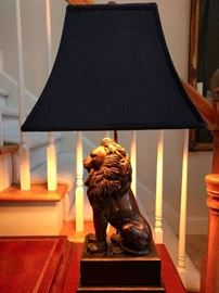 Proud Mary lion lamp, on wooden base.