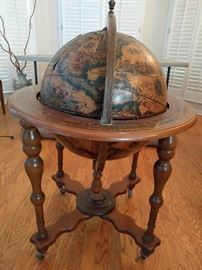 Very cool leather globe that swivels, is on wheels and opens to a bar - next pic.