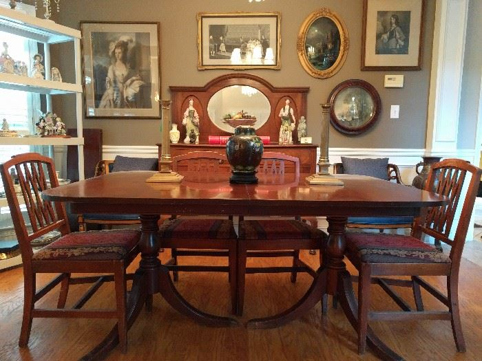 Pristine 1940's mahogany dining table, with three leaves and six side chairs, by Drexel.