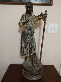 Vintage spelter harp girl. It's kinda cool, seems to be a lamp base. Re-string her harp and she'll follow you anywhere. Yep.