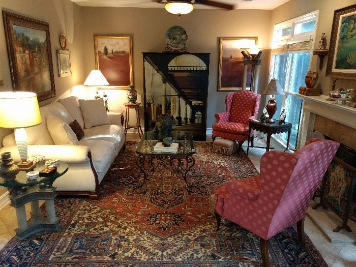 Lovely living room, with lot's of art, anchored by a 10' x 13' Persian Heriz rug, pair of wingback armchairs, hand painted Italian chest, torchiere & matching side table, heavy wrought iron/beveled glass coffee table, etc.