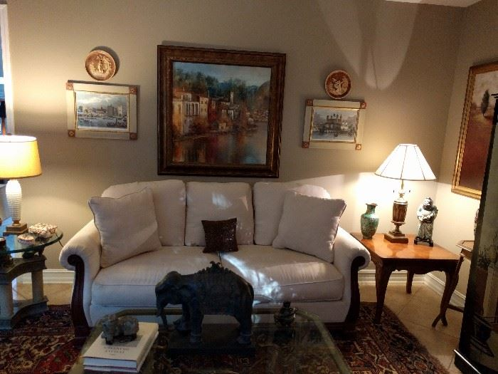 Very comfy couch, cool Italian artwork, inlaid wooden side table, Asian cloisonné vase and porcelain figure. Check out the elephant on the coffee table - it's special!