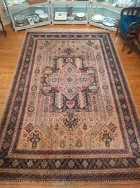 """Very good condition Pakistani rug, hand woven, 100% wool face, measures 6' 9"""" x 9' 2""""."""