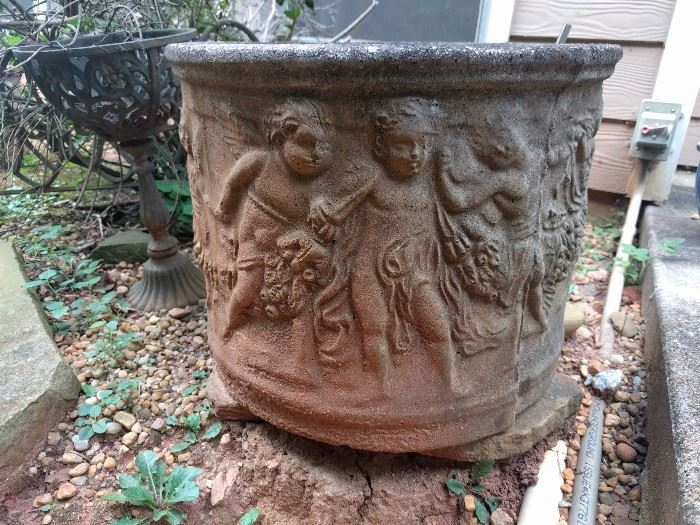 There's a pair of these frolicking putti concrete planters. Putti can frolick, don't judge.