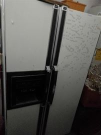 Horrible shot of this side-by-side refrigerator/freezer. It's in the very corner of the garage and she didn't decide until late this evening that she wanted to sell it.  I was over it, but tomorrow's another day and You'll get a much better shot of this garage workhorse.
