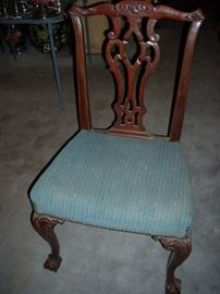 One of the Seven Chairs with the Dining Table