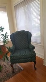 One of a pair of wing back chairs By Ethan Allen