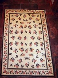 Traditional needlepoint floral rug purchased in Portugal