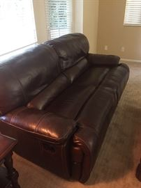 Two of these leather reclining couches. Make an offer!