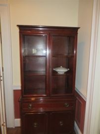 Mahogany china cabinet. two glass doors , one drawer and two doors at bottom