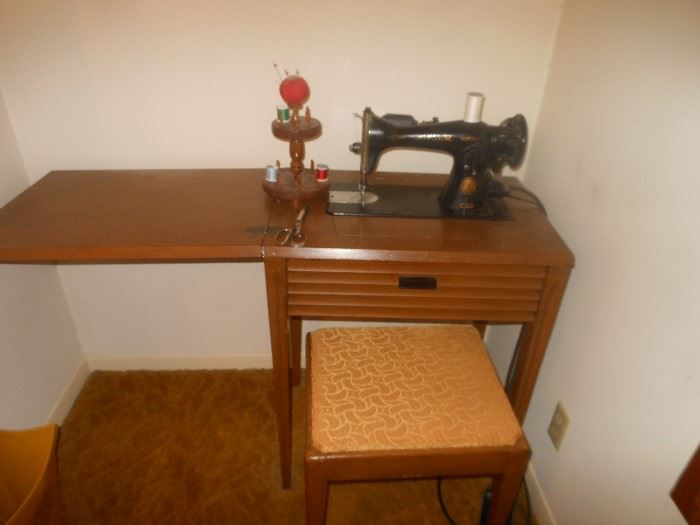 listed by the gypsy junk lady electric vintage singer sewing machine in cabinet with matching bench second sewing machine cabinet without machine